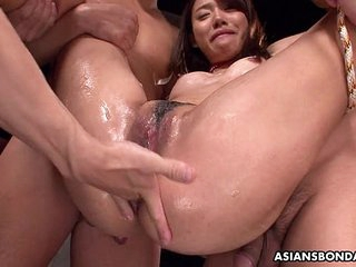 Asian bitch has a threesome..